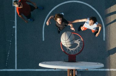 willis towers watson, basket ball, two men playing, reaching