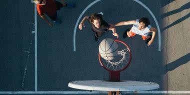 willis towers watson, basketball, two men playing ball, reaching, health, fittness
