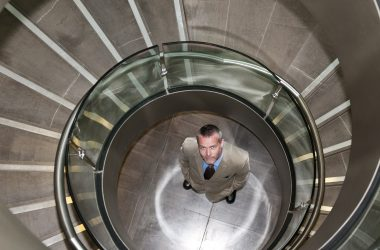 willis towers watson Businessman standing in spiral staircase
